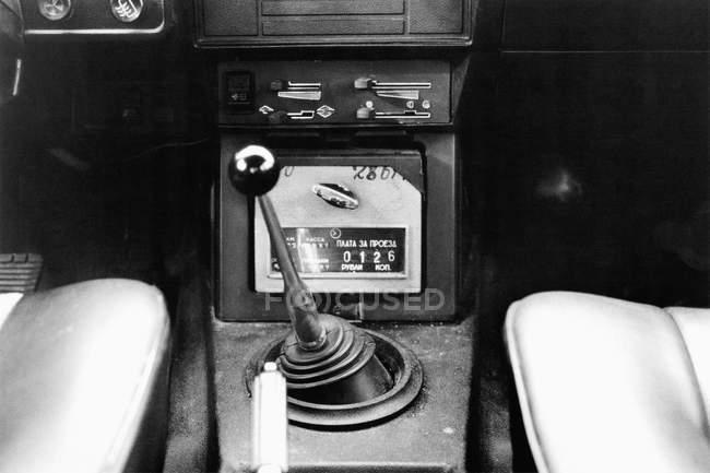 Interior of car with retro taxi counter — Stock Photo