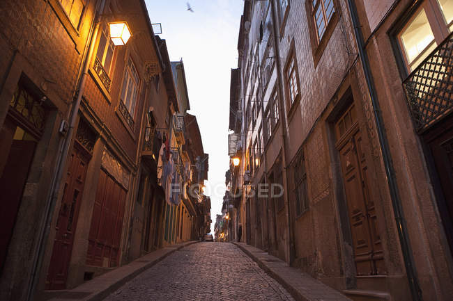 Low angle view of empty town street at evening — Stock Photo
