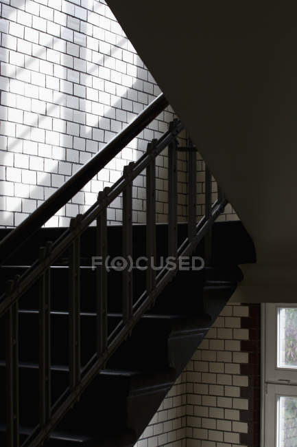 Shadow shapes on brick wall formed by staircase — Stock Photo