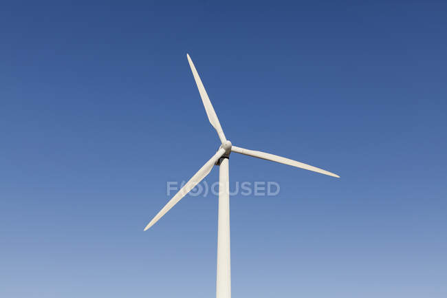 Low angle view of wind turbine over blue sky — Stock Photo