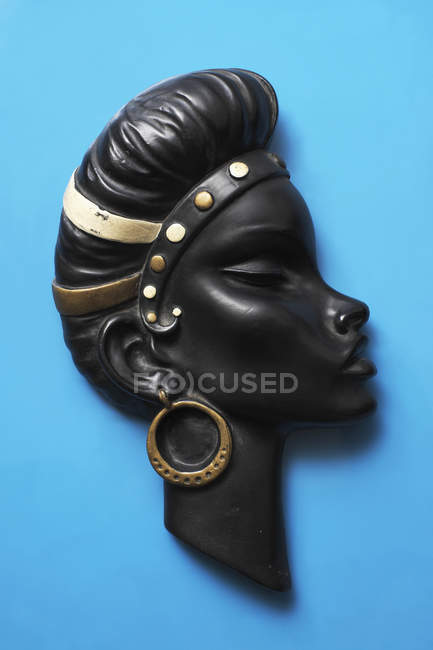 Vintage wall hanging figurine of woman with headband and earrings — Stock Photo