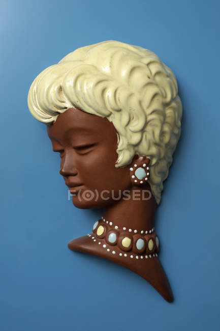 Retro silhouette of woman with short blond hair on blue — Stock Photo