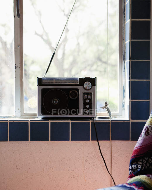 Radio on tilled window sill at home — Stock Photo