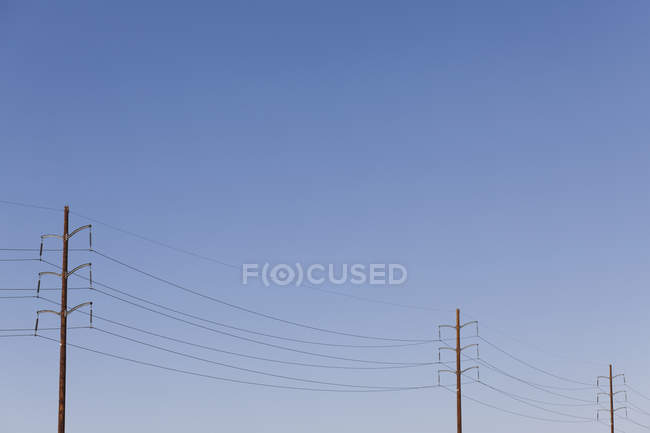 Power lines against clear sky — Stock Photo