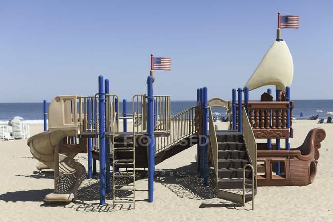 Playground look like ship on sand beach — Stock Photo