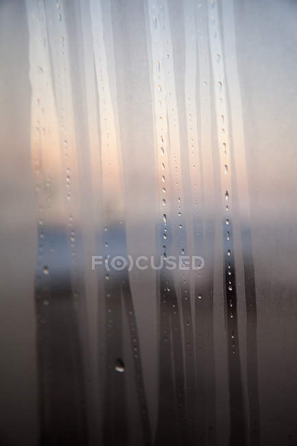 Fogged up window with streaks — Stock Photo