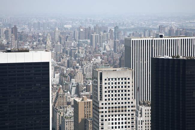 Hazy Manhattan skyline with modern buildings, New York City, USA — Stock Photo