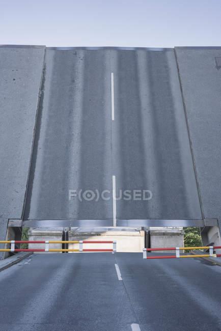 Front view of open drawbridge in city scene — Stock Photo