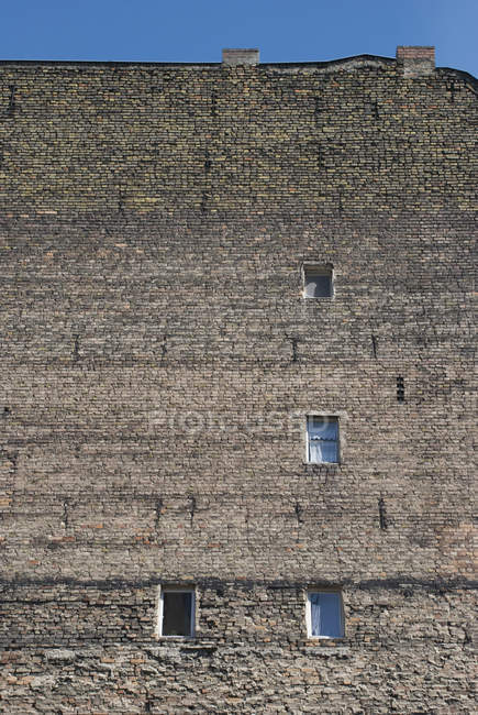Low angle view of shabby brick wall of building — Stock Photo