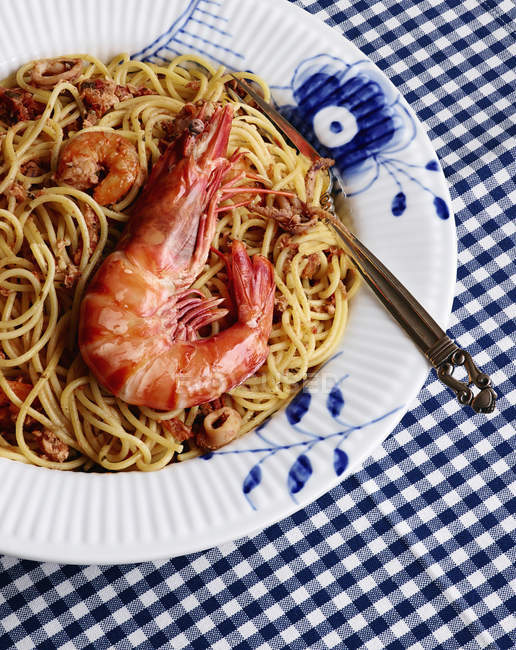 High angle view of prawns and noodles on plate — Stock Photo