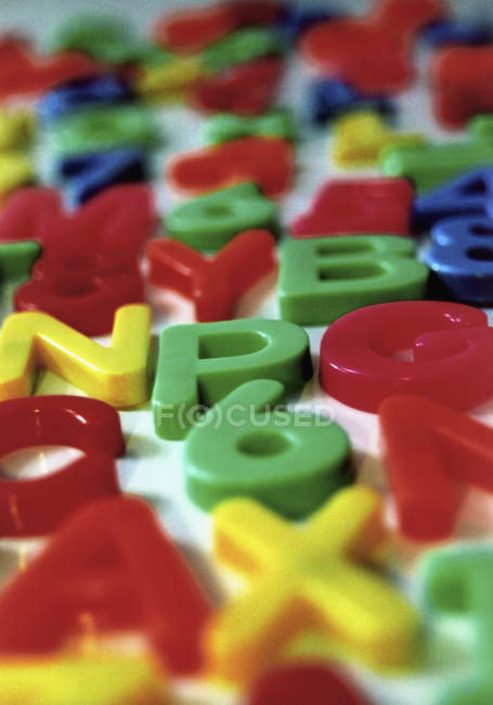 Full frame shot of various plastic letters and numbers — Stock Photo