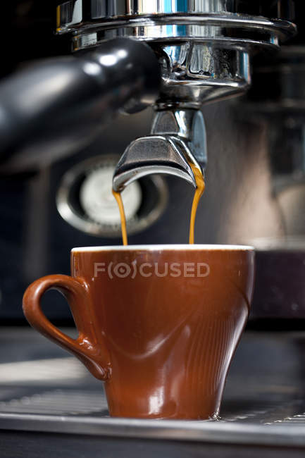 Double shot of espresso being poured from espresso maker — Stock Photo
