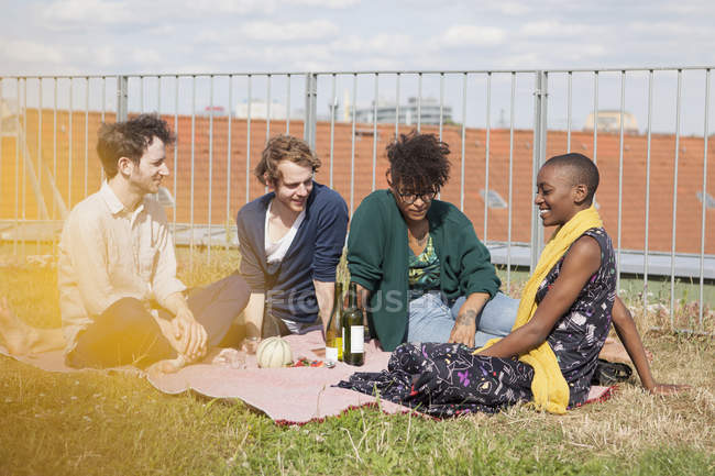 Friends spending leisure time on terrace garden — Stock Photo