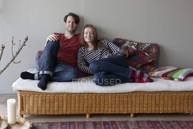 Portrait of Couple lying on cozy sofa at home — Stock Photo
