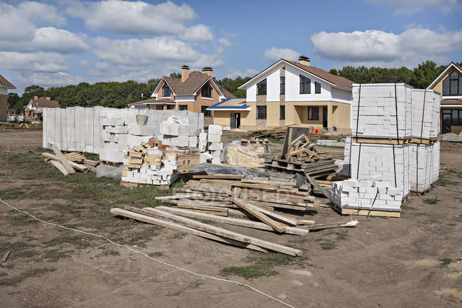 Construction material in front of house on summer day — Stock Photo