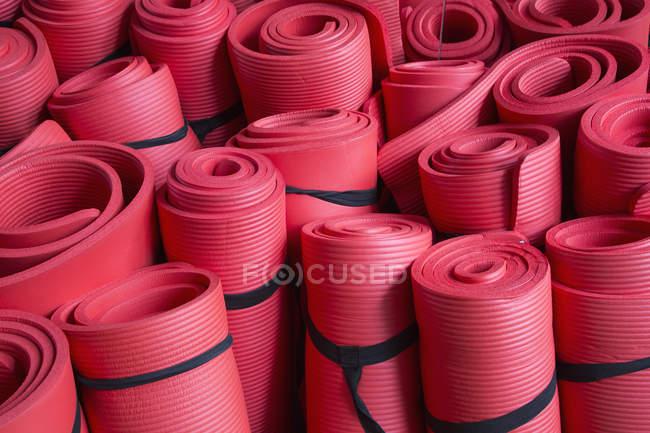 Full frame shot of red yoga mats — Stock Photo