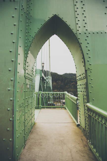 Metal arch on green bridge — Stock Photo