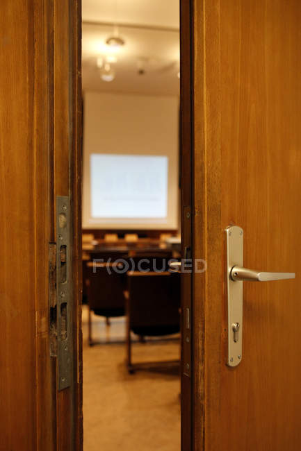 Interior of meeting room seen through opened door — Stock Photo