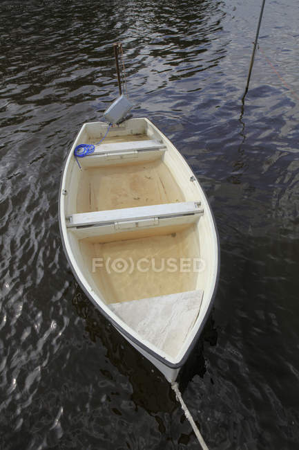 Moored boat filled with water in lake — Stock Photo