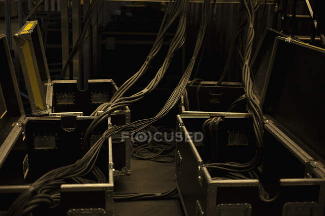 Power cables and open boxes at concert backstage — Stock Photo