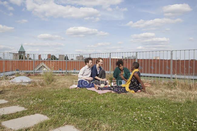 Friends spending leisure time on terrace garden — Stock Photo