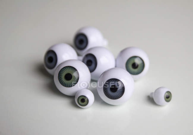 Close up view of artificial eyeballs on white table — Stock Photo