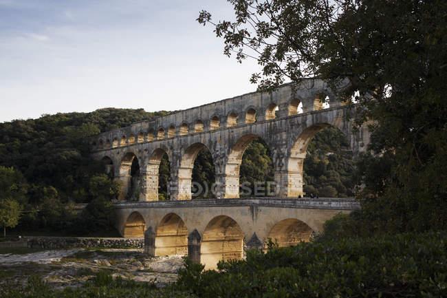 Distant view of Pont du Gard over Gardon River — Stock Photo