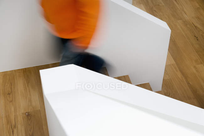 Crop of person moving up wooden steps — Stock Photo