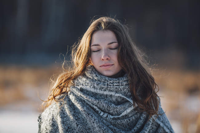 Close-up of woman with eyes closed standing outdoors — Stock Photo