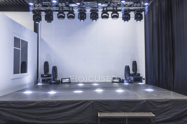 Interior view of illuminated empty stage in studio — Stock Photo