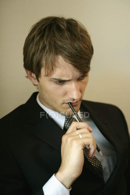 Man with pen in his mouth — Stock Photo