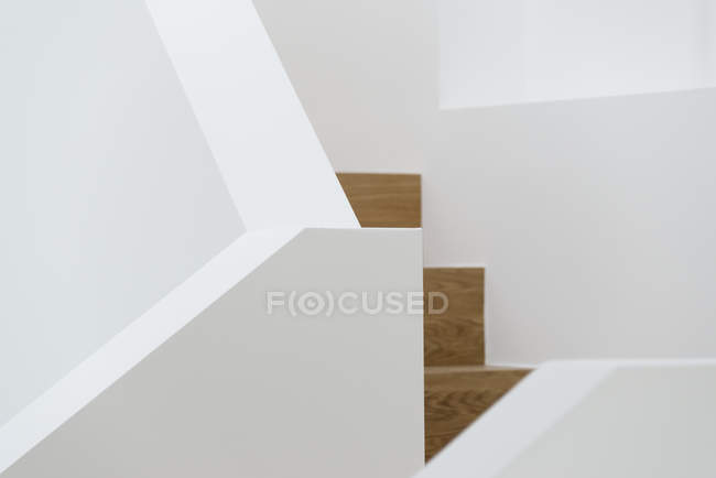 Close up view of wooden steps and white railing — Stock Photo