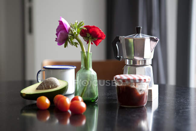 Table with espresso maker and ingredients for breakfast — Stock Photo