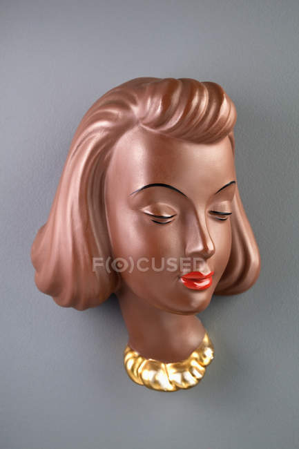 Figurine of mannequin head on grey background — Stock Photo