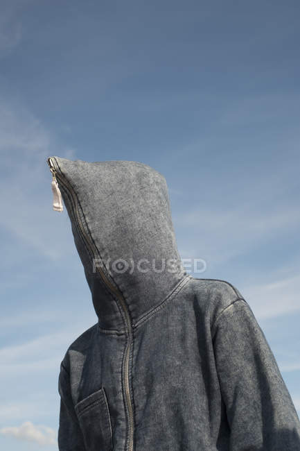 Low angle view of person covered with hood against sky — Stock Photo