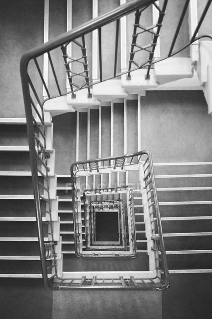 Directly above shot of square spiral staircase — Stock Photo