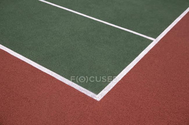 Detalle del patrón de corte de tenis vacía - foto de stock