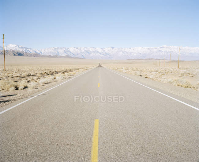 View to long road in remote area — Stock Photo