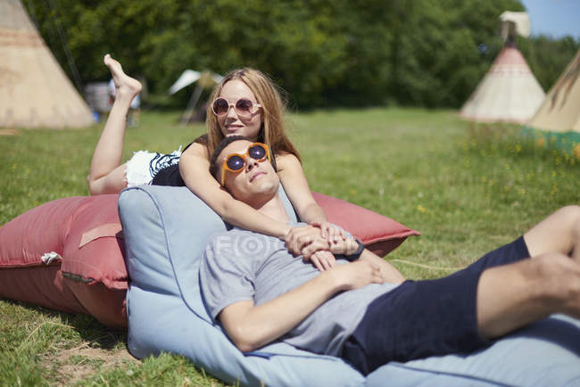 Young couple lying on pillows while glamping — Stock Photo