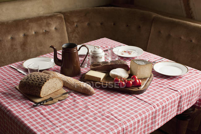 Simple rustic meal laid out on set table — Stock Photo