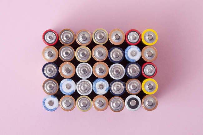 Various batteries arranged into rectangle — Stock Photo