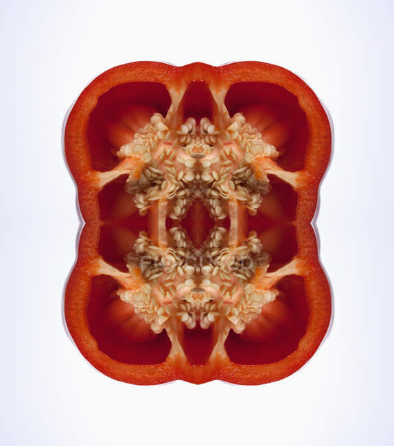 Composite of mirrored cross sections of red bell peppers — Stock Photo