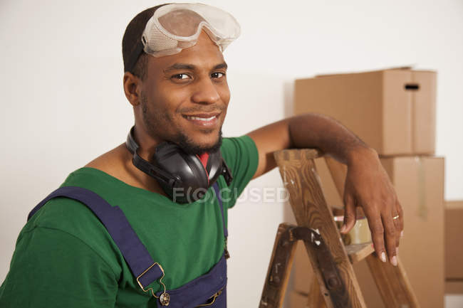 Portrait of man renovating new apartment — Stock Photo