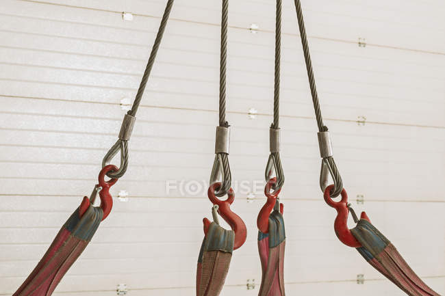 Close up view of pulleys and ropes against wooden wall — Stock Photo