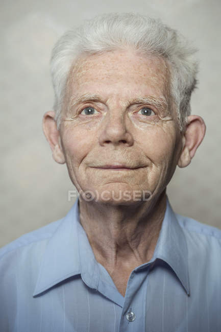 Happy senior man looking away — Stock Photo
