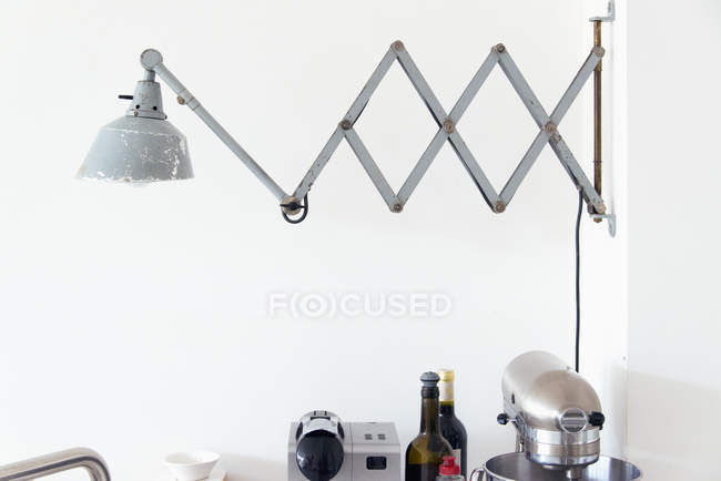Metallic lamp over kitchen counter — Stock Photo