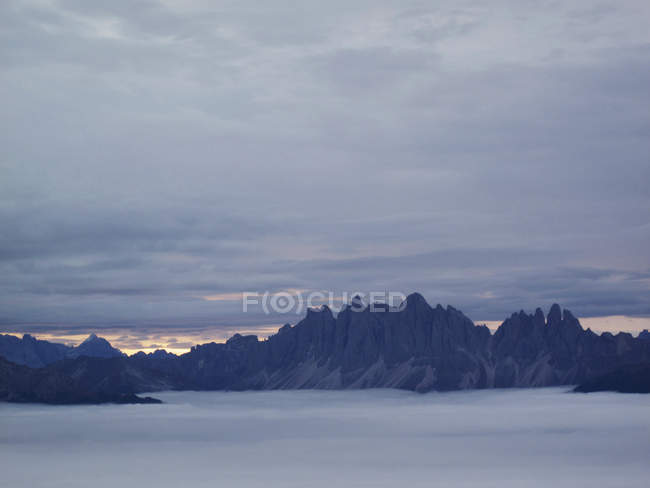 Scenic view of misty mountains against cloudy sky — Stock Photo