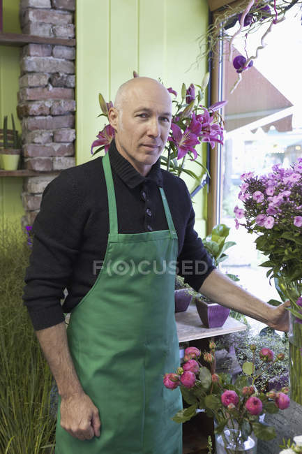 Portrait of male florist standing in flower shop — Stock Photo