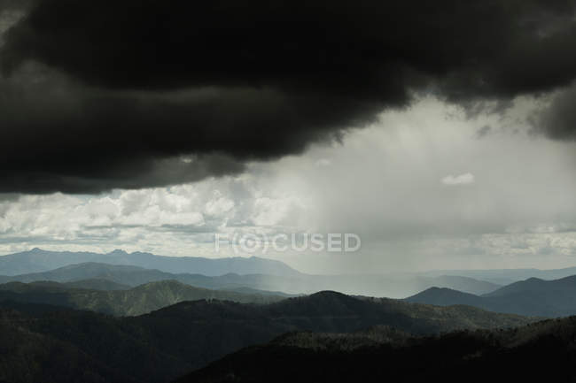 Scenic shot of storm clouds over mountain ranges — Stock Photo