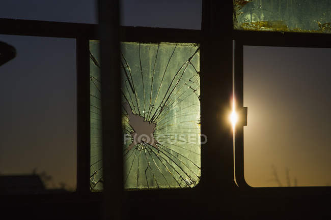 Close up view of broken window of vehicle during sunset — Stock Photo